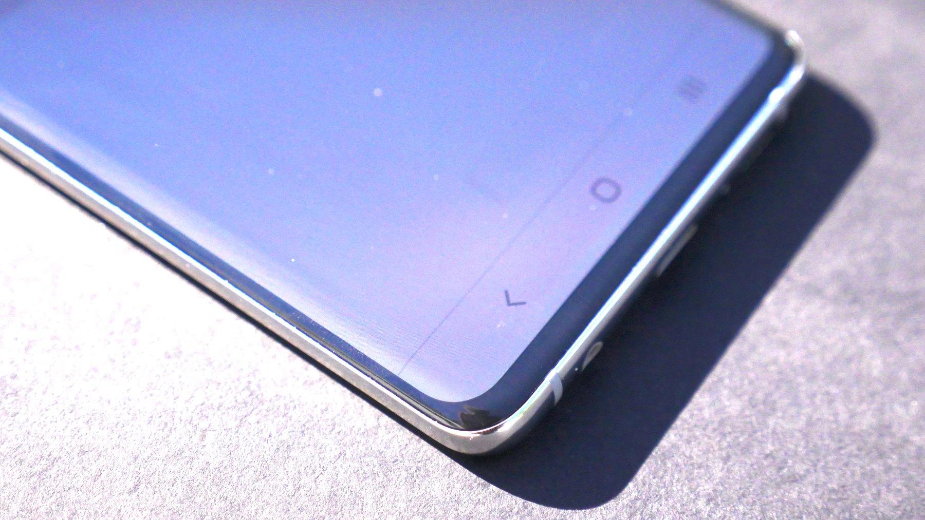 The Samsung Galaxy S10 fingerprint sensor is visible in