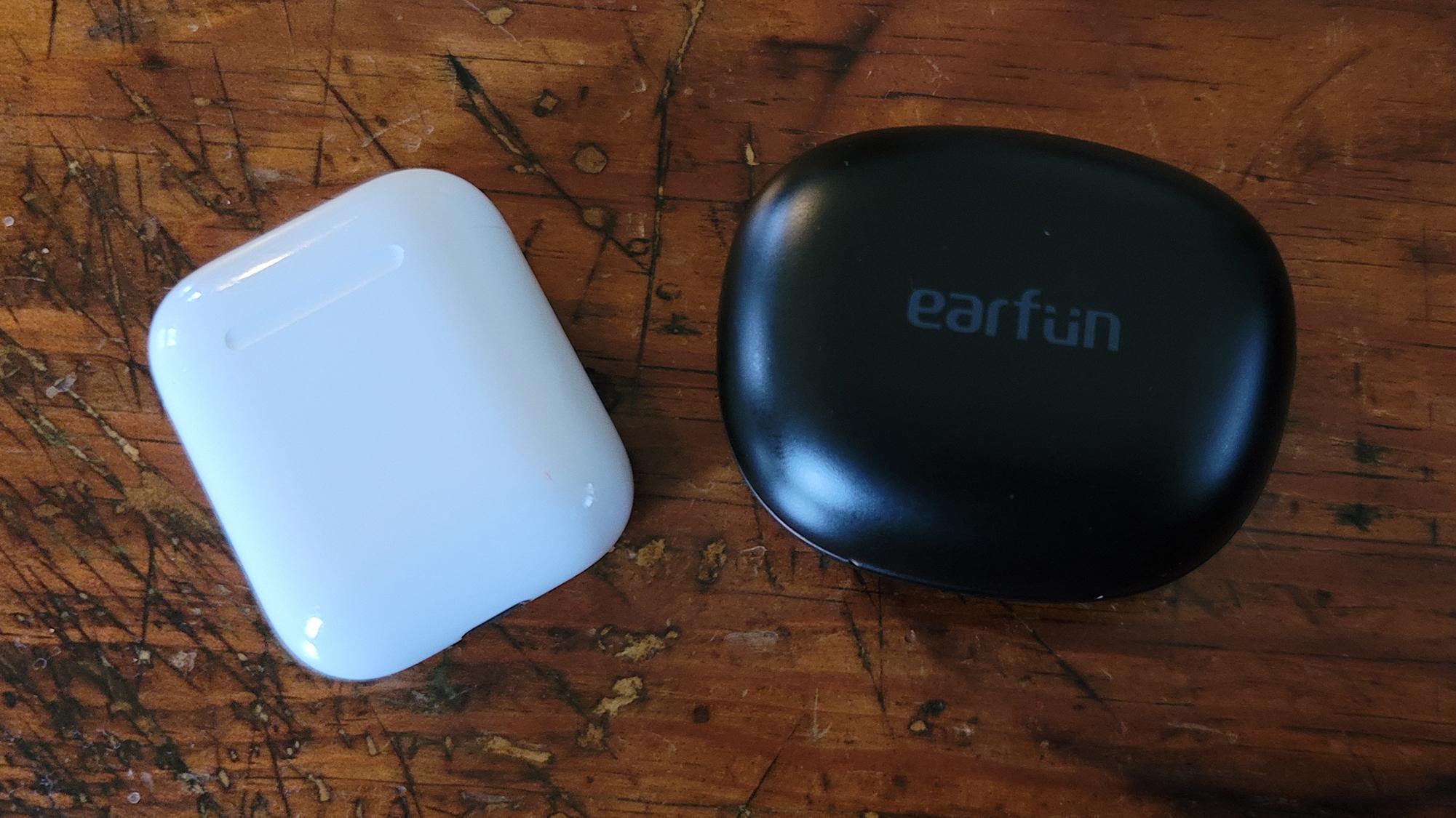 Earfun Air Pro true wireless earbuds case next to Airpods case